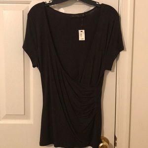 Short sleeve, deep v-neck, brown.